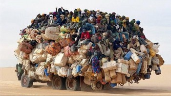 Africa Truck Overloaded With People - Network Saturation